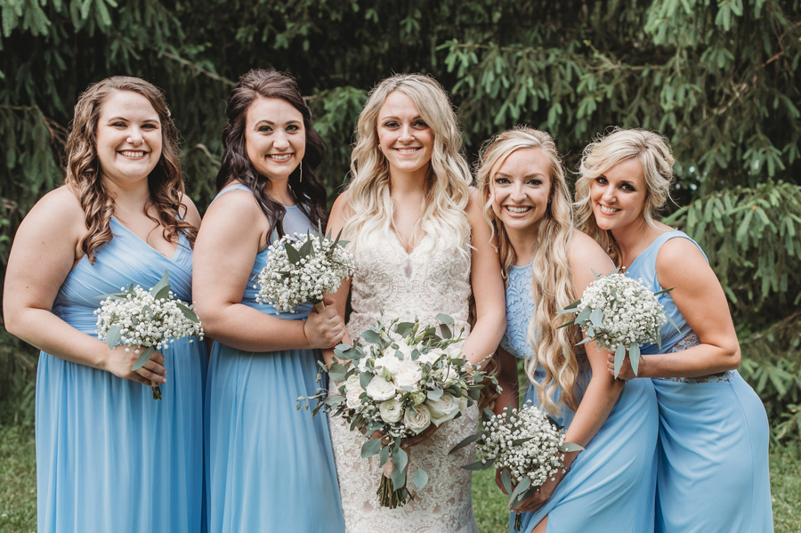 bride with bridesmaids in ice blue dresses