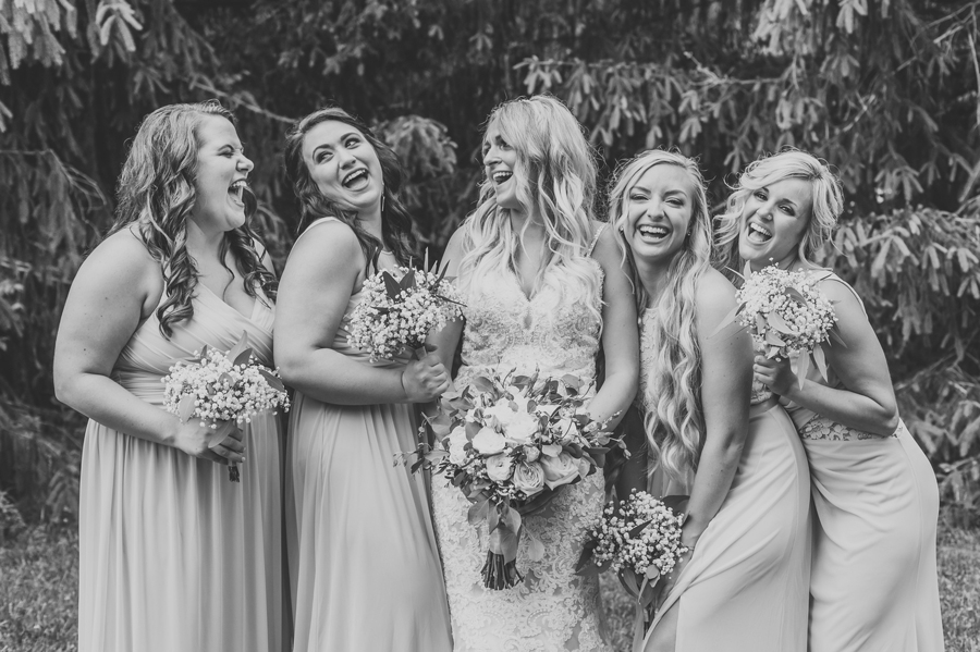 candid laughing photo of bride with bridesmaids