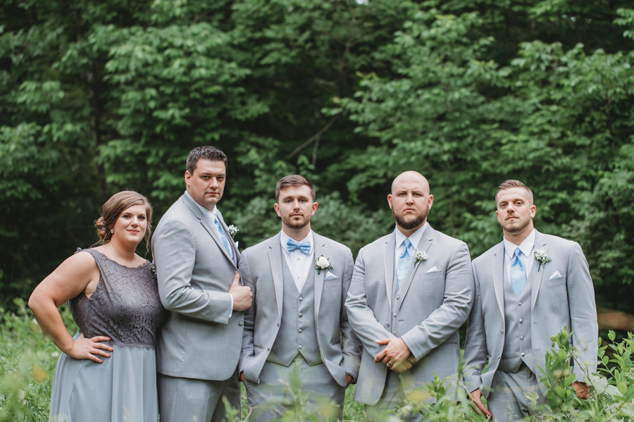 groom and groomsmen and groomsmaid in gray and blue