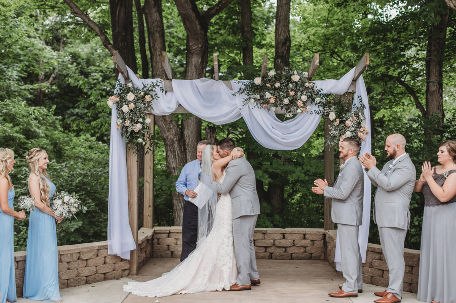 first kiss as married couple at Pine Lodge