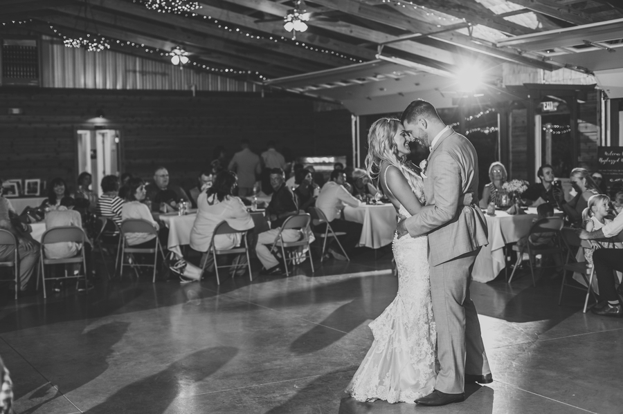 black and white photo of first dance with couples foreheads together at Pine Lodge