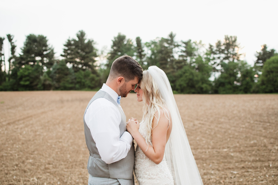 married couple with foreheads together at Pine Lodge Wedding
