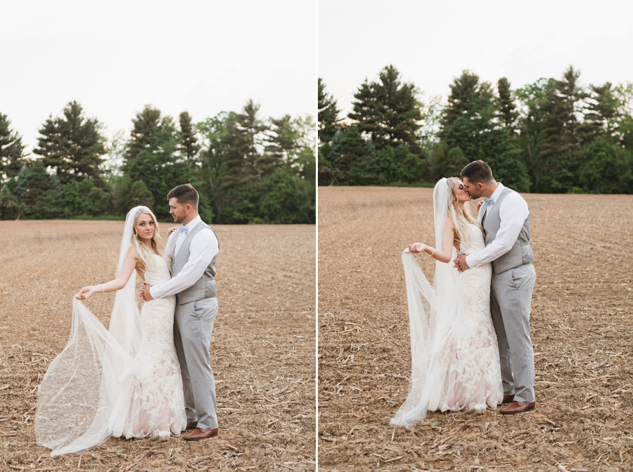 couple kissing in field at Pine Lodge in Washington Court House