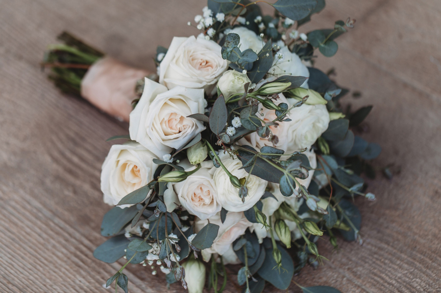 close up of bouquet with roses and eucalyptus