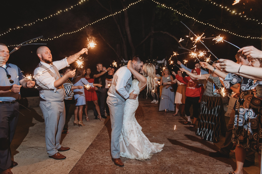 married couple kissing at sparkler send off at Pine Lodge Wedding