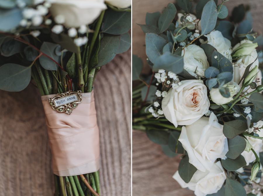 close up of brides bouquet and broach pin