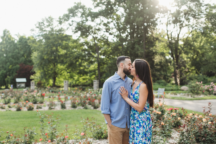 engaged couple kissing during golden hour