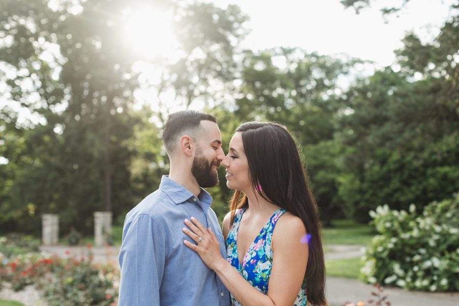 romantic kissing photo of couple at Whestone Park of Roses