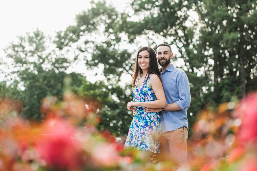 colorful image of engaged couple looking at camera