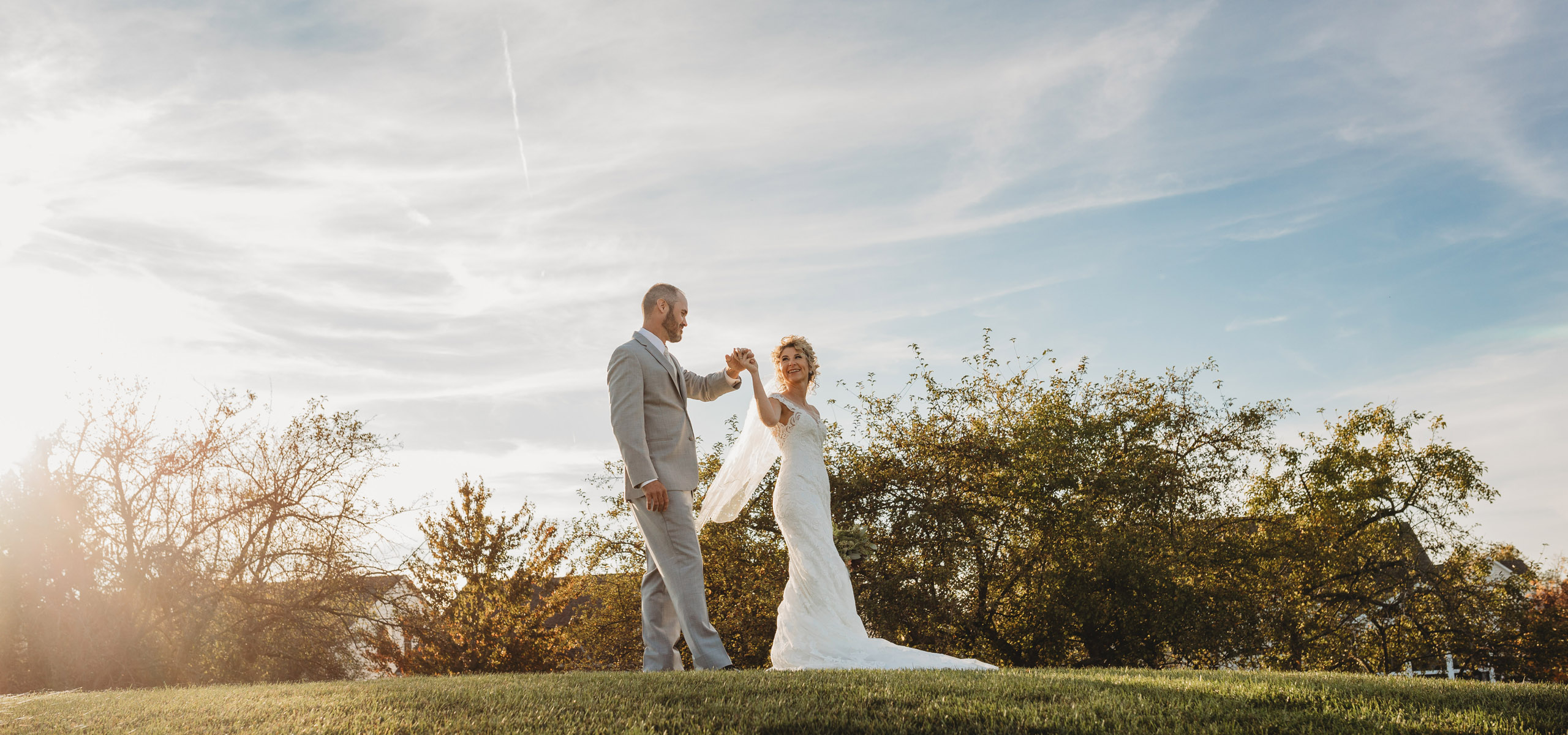 married couple dancing in sunset on a hill in Columbus Ohio